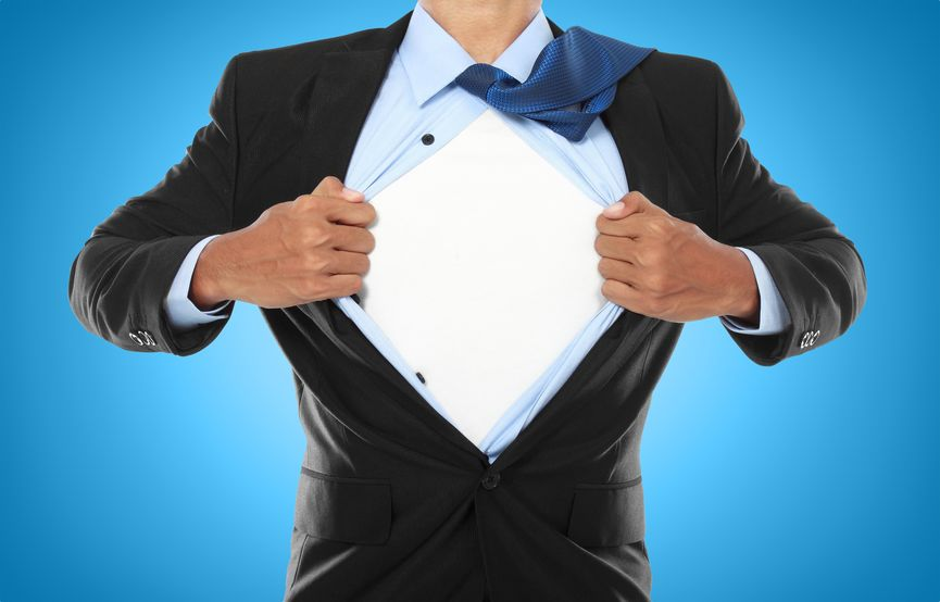 14314603 - businessman showing a superhero suit underneath his suit